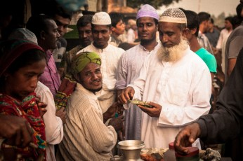 A tea-stall with it's customers inside the cattle market.