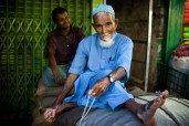 An old shopkeeper and his son in Khulna, Bangladesh.