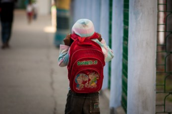 A kid going to school.