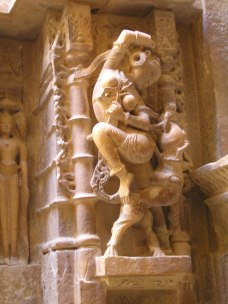 Female figure playing with a pet