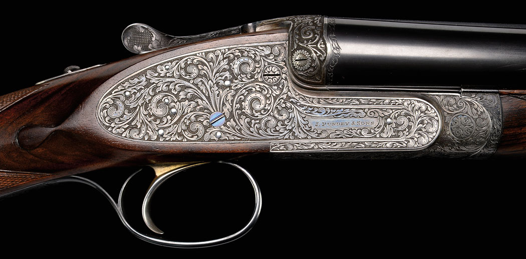 An exquisite Purdey 16-bore extra-finish game gun engraved by Harry Kell.