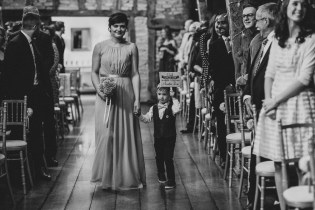 Pageboy with cute sign at ceremony
