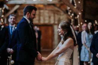 The look of love between bride and groom at Bassmead Manor Barn wedding