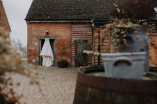 Wedding dress hanging at Bassmead Manor Barns