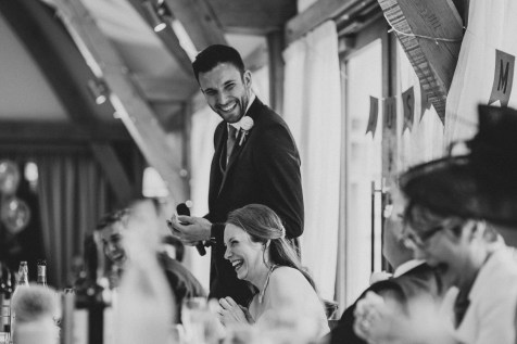 Groom making everyone laugh during the speeches at Bassmead Manor Barns