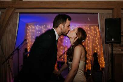 Bride and groom sharing a kiss on the dance floor