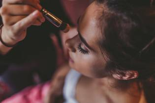 Bridesmaid having her makeup done