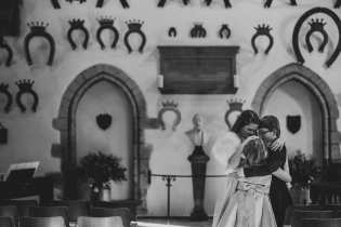 Loving embrace at Oakham Castle Wedding