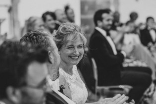 Bride laughs at wedding reading