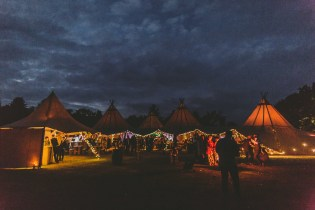 Tipi festival wedding all lit up