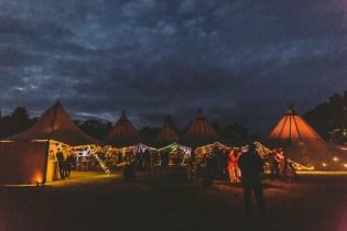 Tipi festival wedding all lit up