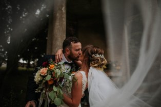 bride and groom kiss for wedding photos
