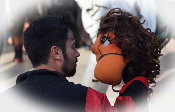 Weird act... Romantic dancing with a puppet