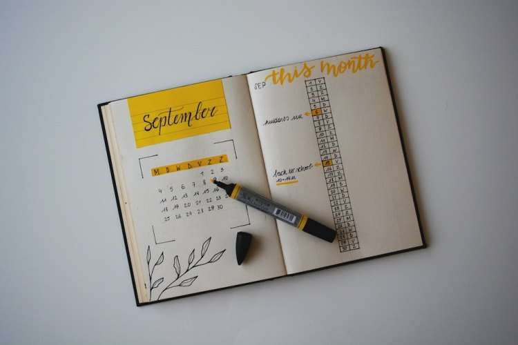 Monthly bullet journaling spread with yellow highlights