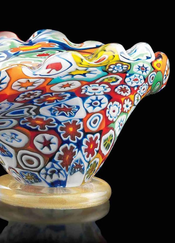 Murano blown glass vase made with multicor murrine, the base of the vase is in 24K gold. The vase is hand blown.