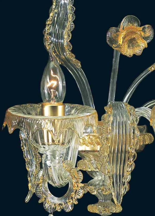 Wall lamp 2 lights in crystal and amber glass, with flower, leaves and pendants, individually hand carved, the result represents an exceptional image both in the structure and in the details. It is one of the most requested wall lamps thanks to the combination of colors suitable for any environment,