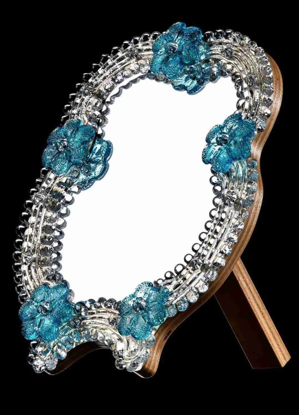 Venetian style table mirror a unique work of its kind. Handcrafted by our glass masters, it blends the art of Murano glass.