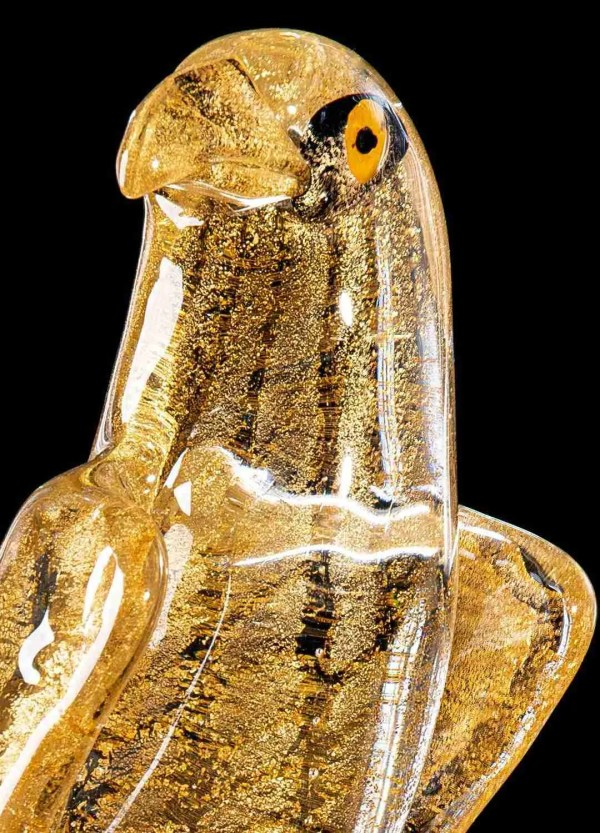 All gold falcon made in Murano glass by hand by our glass masters, the falcon is supported by a transparent glass base.