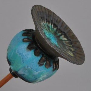 Blue poppy seed head