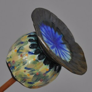 multi-coloured, slip-decorated ceramic poppy seed head