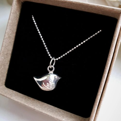"Handmade Solid Sterling Silver Bird charm hangs delicately off 20"" Sterling Chain"