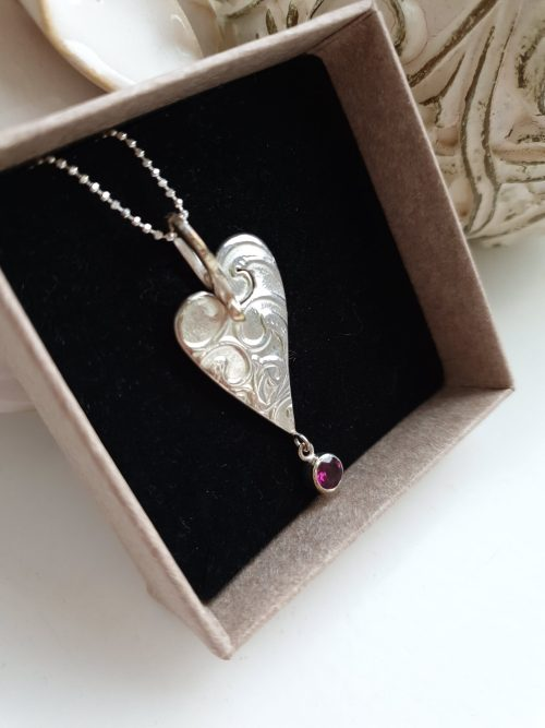 Sterling Silver whimsical heart pendant with Rhodolite Garnet drop