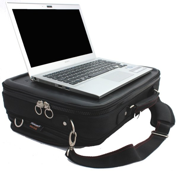 Trabasack Max expandable wheelchair lap tray with laptop on top