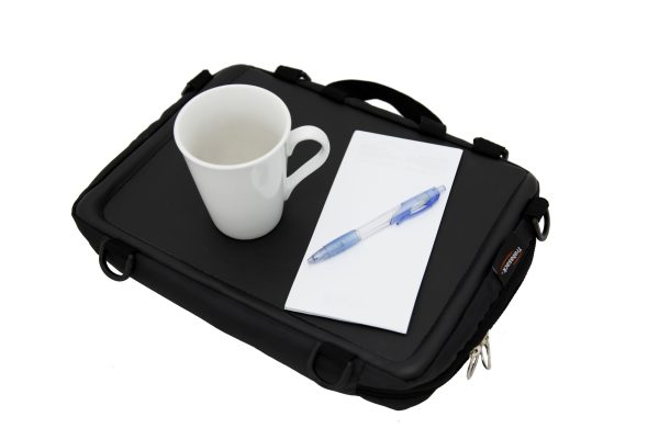 Trabasack Mini wheelchair lap tray and bag with pen, paper and mug on top