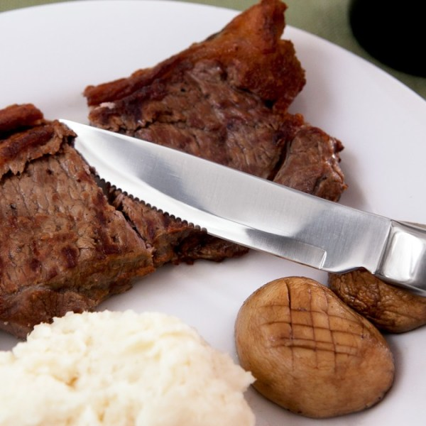 Knork steak knife cutting steak