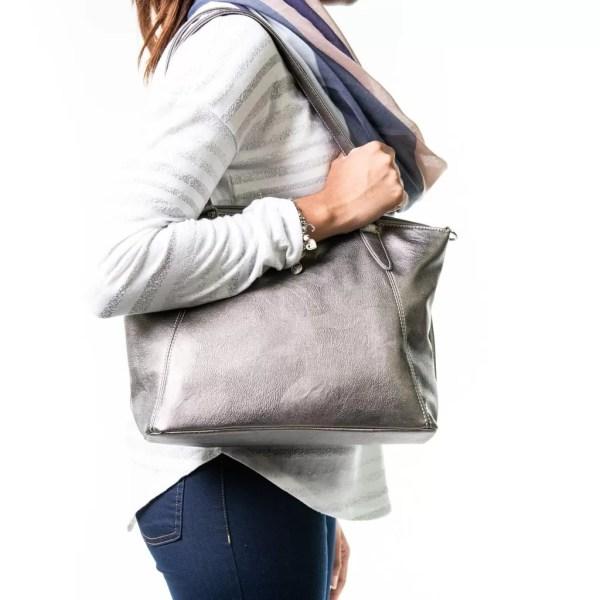 Sam Renke's silver handbag on a woman's shoulder