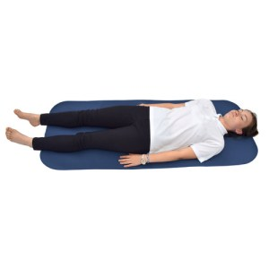 Large changing mat for disabled adults with a woman lying on it