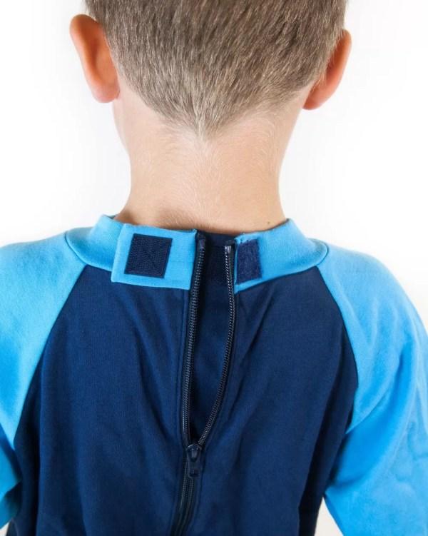 Hidden zip on the back of Seenin children's turquoise and navy sleepsuit