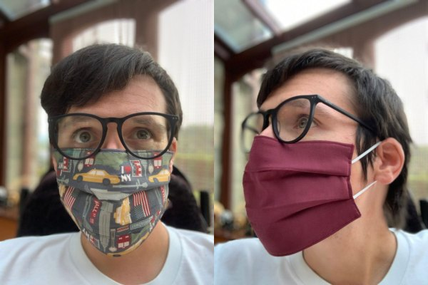 Image is two photographs side-by-side, of a man wearing a New York-themed fabric face mask. In the first photograph he is facing the camera to show the design and fit of the mask. The fabric's design features yellow taxis, New York street signs, the Empire State building and other iconic New Yorkn imagery. In the second image the man is looking to the left, and he is wearing the mask inside-out to illustrate that the inner lining is burgundy in colour.