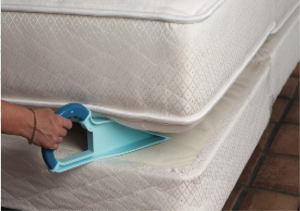 Bed Made easy lifter wedged under mattress to allow bed to be made