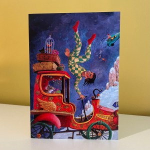 Image is a photograph of a christmas card by Peter Rodulfo featuring a red, winged fantasy car being jocularly driven by a harlequin-type character, in a winter-like land