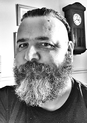 Image is a black and white stylised photograph of Zec Richardson Disability Horizons product reviewer
