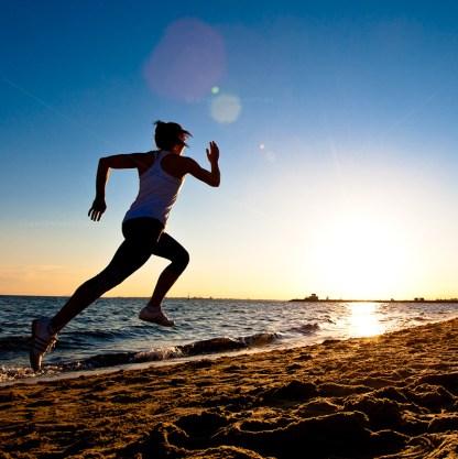 woman running on beach.