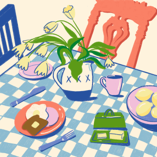 Table and chairs with breakfast food