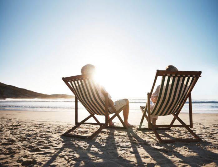 Couple sitting on the beach in beach chairs