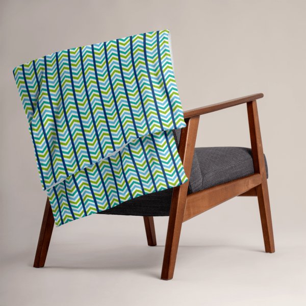 chevron blanket draped over the back of a chair