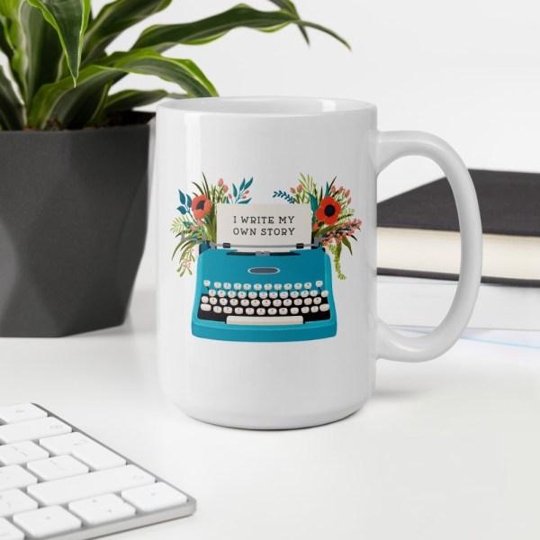 15oz my own story typewriter mug on desk