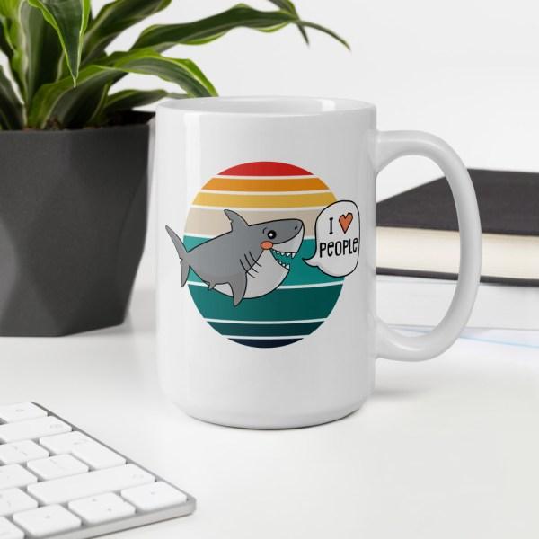15oz I love people shark mug on desk