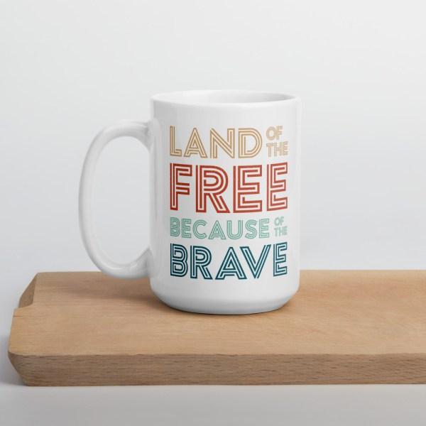 15oz land of the free mug on cutting board