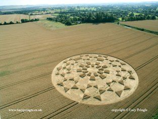 Etchilhampton, Nr Devises, Wiltshire. 19 August 2015. Wheat. c. 230 ft (70m) diameter. A complex nine fold circle containing pointed stars around a centre of rectangles.