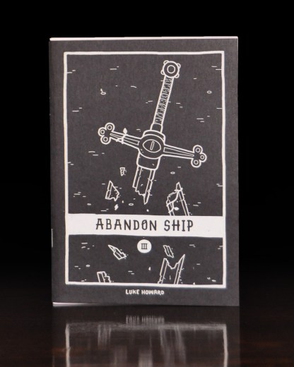 A photo of the small zine Abandon Ship volume 3. The cover features an illustration of a Broken Sword.