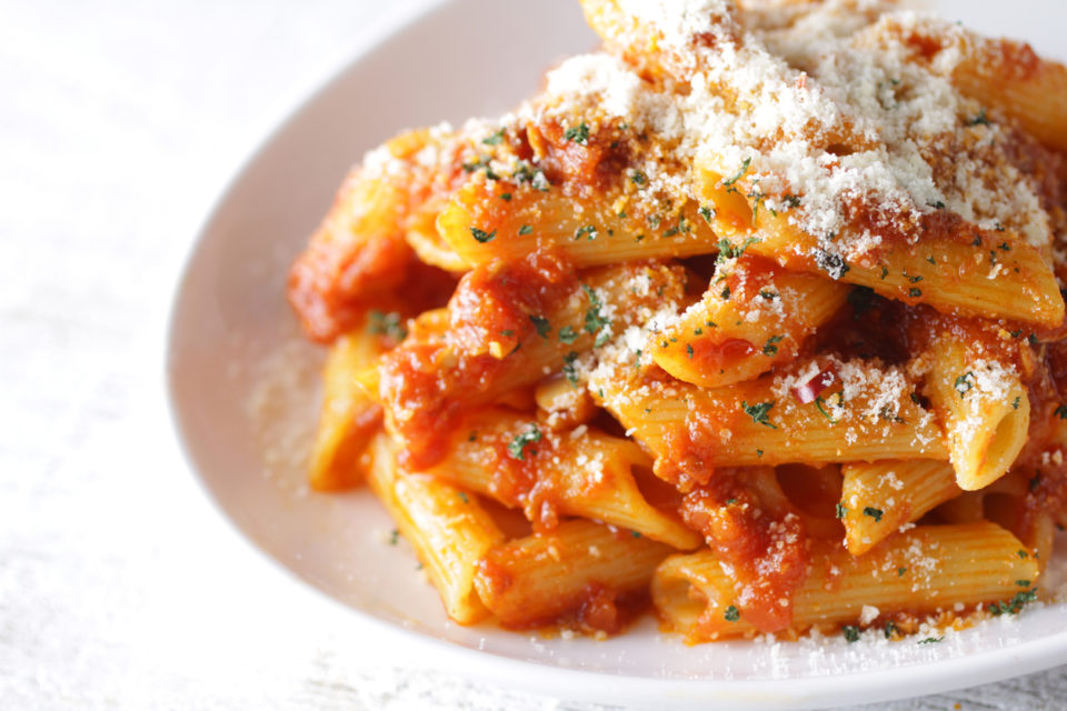 Penne pasta with tomato sauce and parmesan cheese