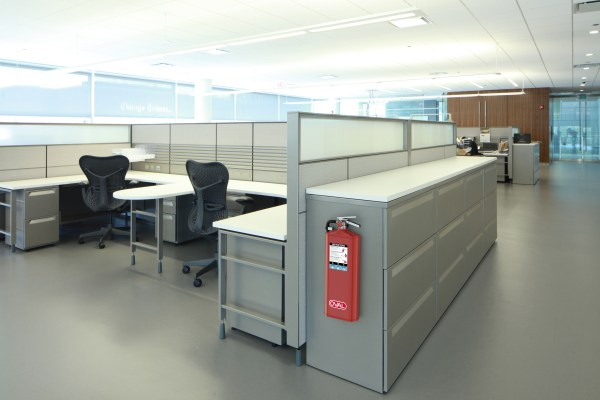 Oval Brand Fire Extinguisher Model 10HABC installed on an Office File Cabinet