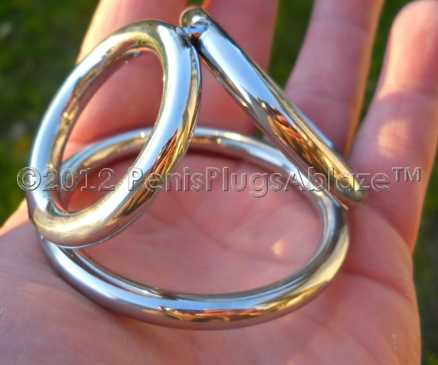 The Largest Of The Three Rings Encircles The Cock And Balls While The Second Largest Ring Goes