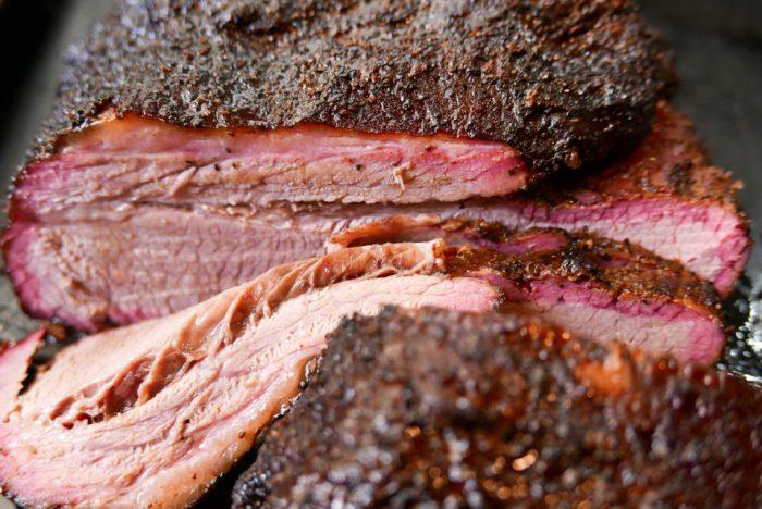 Sliced smoked brisket, close-up.
