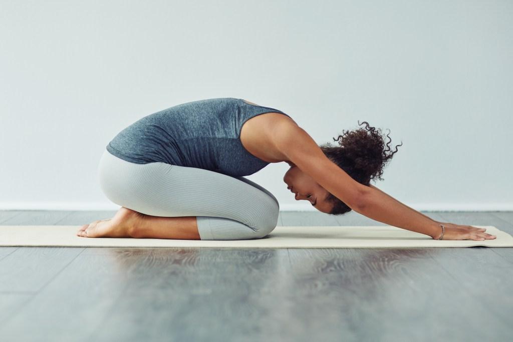 Benefits Of Yoga For Runners. Woman doing yoga.